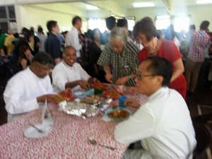From left, seating: Fr Suresh, Fr Joseph and Fr Paul being served at the event.